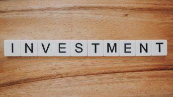 Investment spelled in scrabble letter blocks