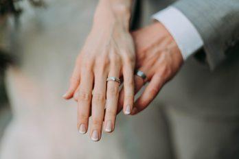 Woman's hand touching man's hand wedding.